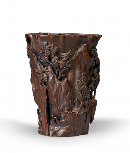 A FINELY CARVED AGALLOCH 'LANDSCAPE AND FIGURE' BRUSHPOT