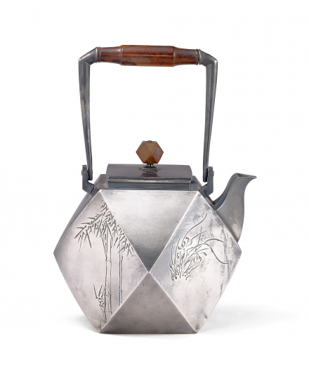 A SILVER 'PLUM, ORCHID, BAMBOO AND CHRYSANTHEMUM' TEAPOT