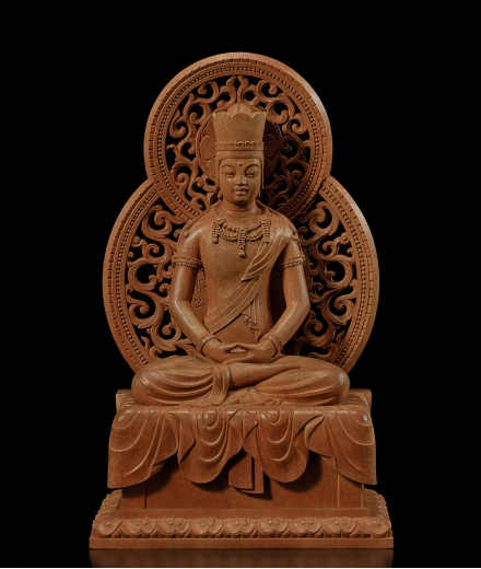A CARVED WOOD FIGURE OF VAIROCANA