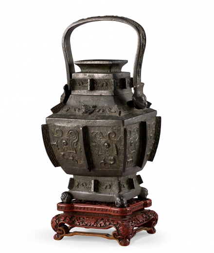 A RARE BRONZE 'BEAST-MASK' RITUAL WINE VESSEL WITH CARVED CINNABAR LACQUER STAND