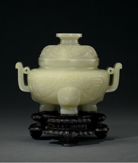 A FINE CELADON AND YELLOW JADE 'BEAST MASK' TRIPOD CENSER AND COVER WITH ZITAN 'JIA' MARK STAND