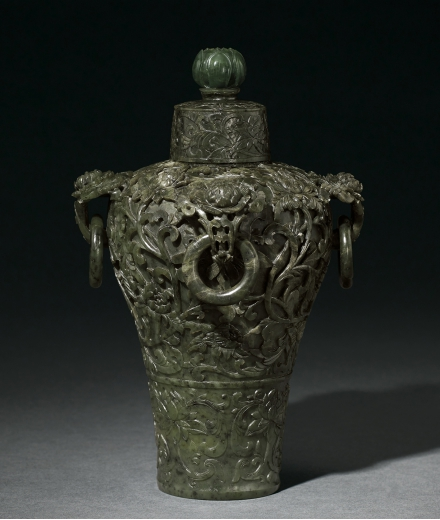 A RARE AND FINE MUGHAL-STYLE SPINACH-GREEN JADE 'LOTUS' VASE AND COVER